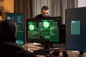 Back view of female hacker writing a malicious malware