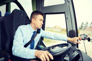 bus driver entering address to gps navigator