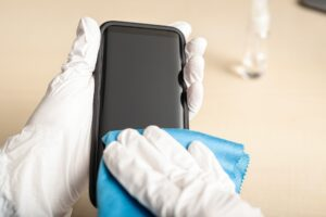 Cleaning smartphone with disinfectant