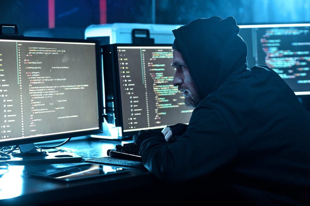 Computer hacker breaking the software