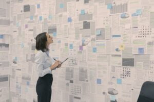 Corporate manager checking financial data and reports