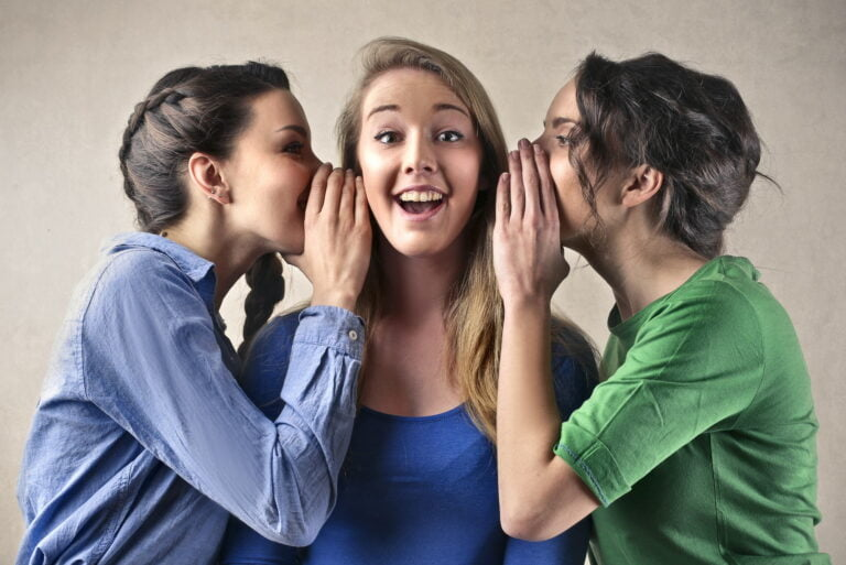 Girls telling secrets