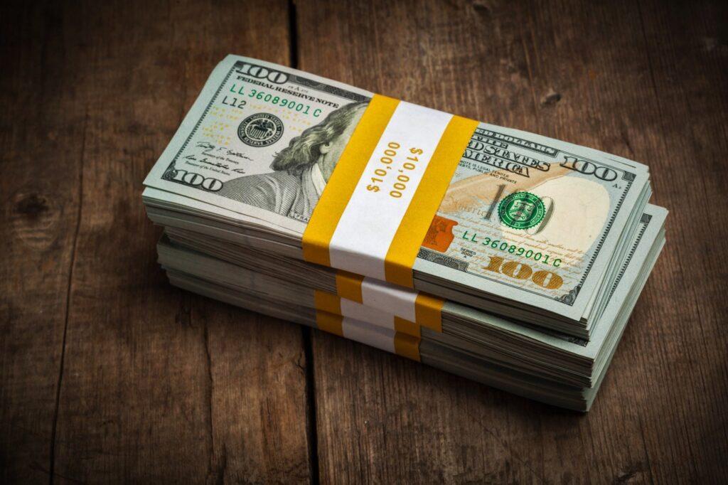 Stacks of 100 dollars banknotes bundles
