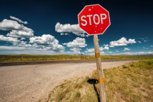 Stop sign on empty highway in Wyoming