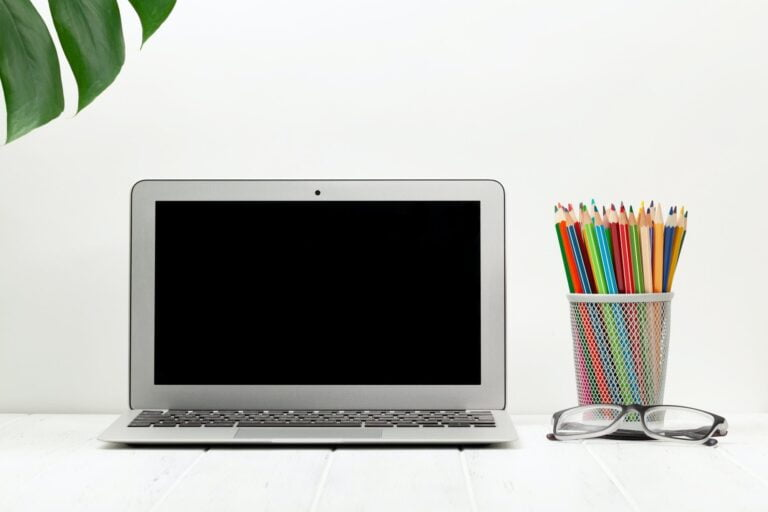 Workspace with laptop computer and supplies