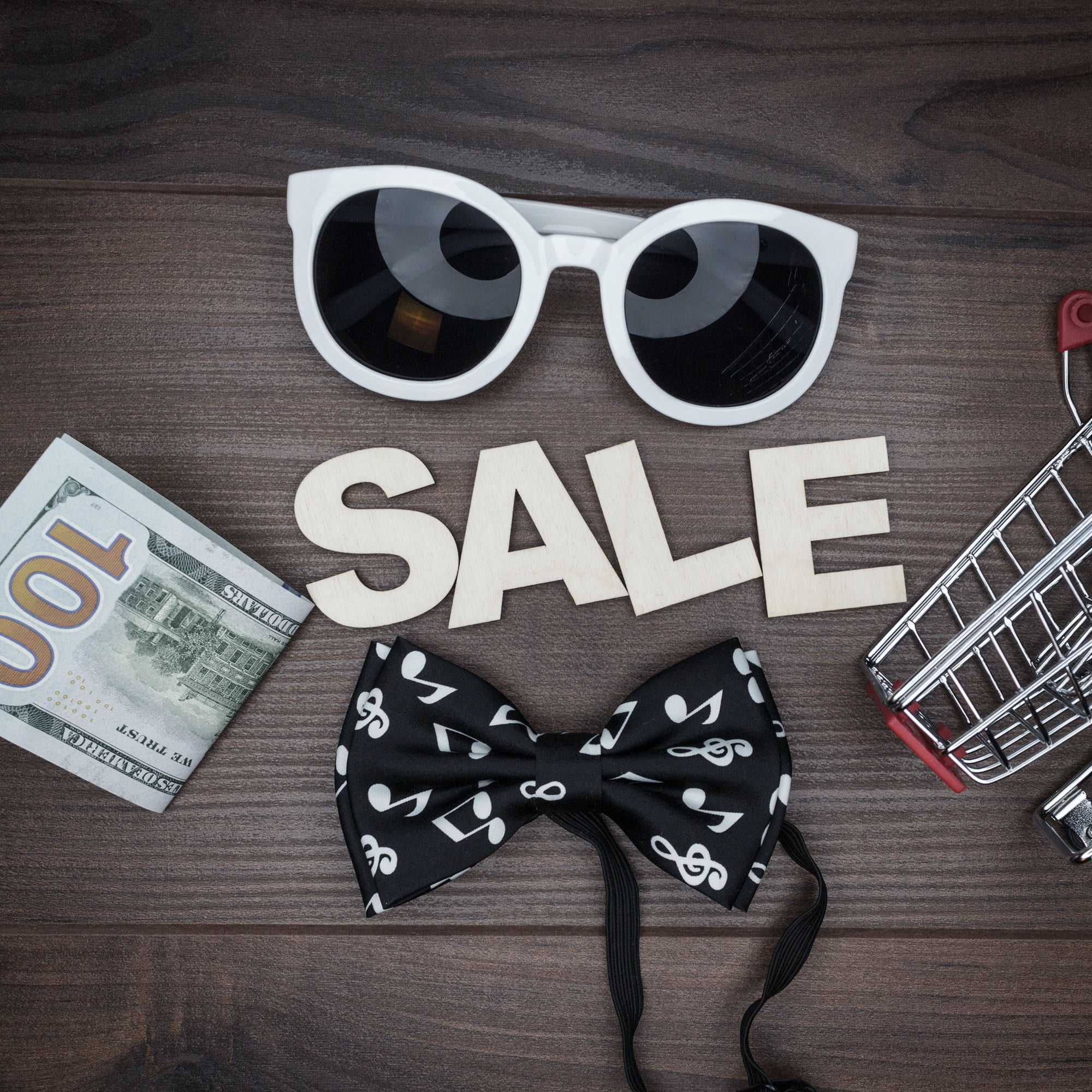 Sale Concept On The Wooden Background
