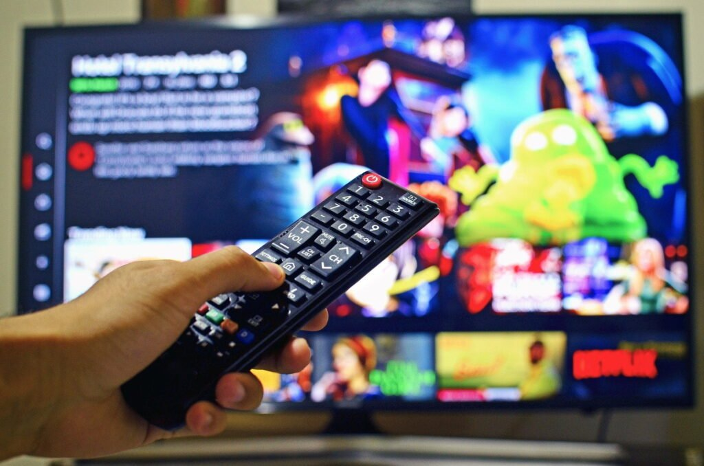 remote control with TV in the background for best stremio addons