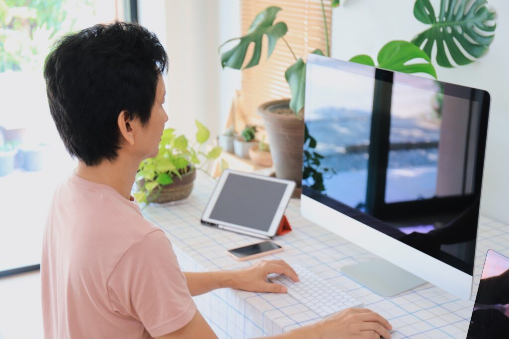 Man working with computer at home.