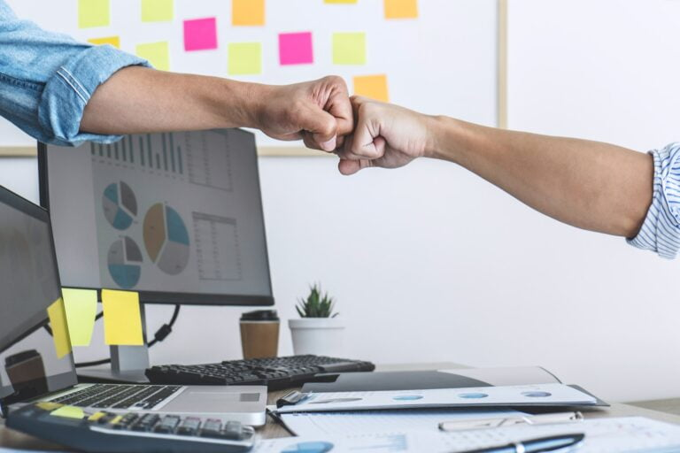 Teamwork of businesspeople partnership giving fist bump to greeting start up business strategy