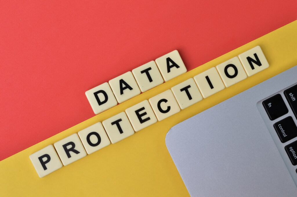 scrabble letters with text DATA PROTECTION over yellow and red background. web application security